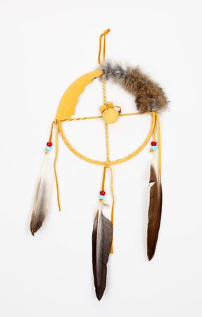 Indian dream catcher over white background photo