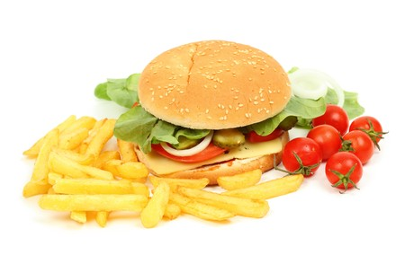 Closeup of a fresh cheeseburger with fries  photo