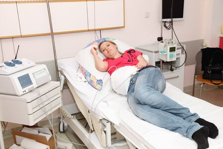 Pregnant woman on bed in the hospital photo