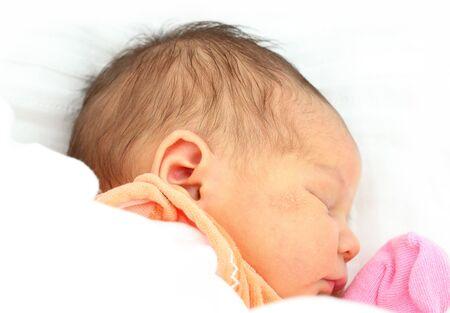 Portrait of a newborn baby girl sleeping photo