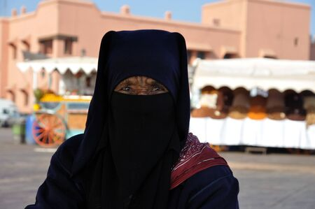 burka: Portrait of a Berber Woman at Djemaa el Fna square in Marrakesh. Photo taken at 22th of November 2008 Editorial