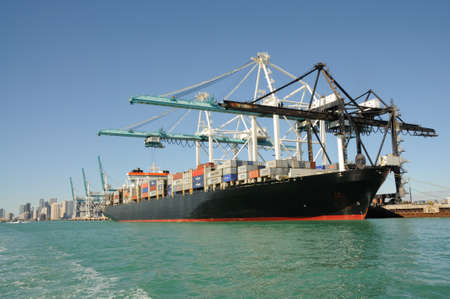 Container ship at industrial port in Miami, Florida. Photo taken at 14th of November 2009 Stock Photo - 8450228