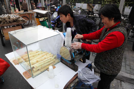Bamboo juice vendor in the street of Shanghai, China. Photo taken at 19th of November 2010 Stock Photo - 8558829