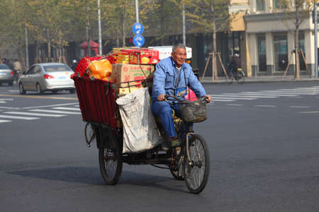 three wheeler: Chinese transportation. Three wheeler like this are very popular in China. Photo taken at 20th of November 2010 in Shanghai