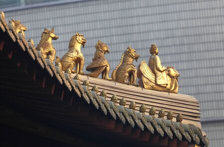 Decoration on the roof of Jing'an temple in Shanghai, China Stock Photo - 8582505