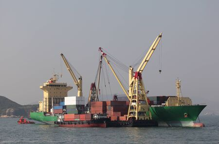 Large cargo ship unloading containers photo