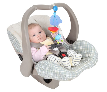 baby carriage: Baby in child car seat isolated over white background Stock Photo
