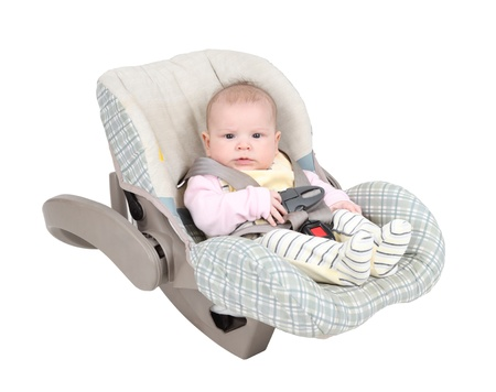 car carrier: Baby in child car seat isolated over white background Stock Photo