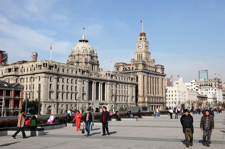 People walking at the Bund in Shanghai, China. Photo taken at 24th of November 2010 Stock Photo - 8577409