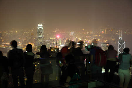 People enjoying the view over Hong Kong from Victoria Peak. Photo taken at 26th of November 2010 Stock Photo - 8626192