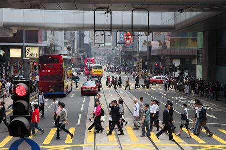 Pedestrians walking over the street in Hong Kong. Photo taken at 30th of November 2010