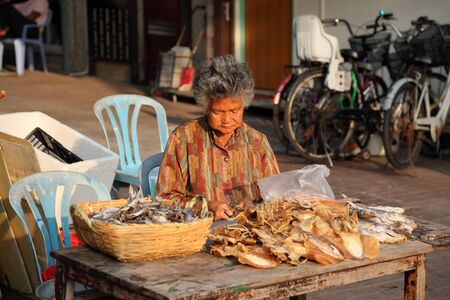 Woman selling dried fish at street market in Cheung Chau, Hong Kong. Photo taken at 3rd of December 2010