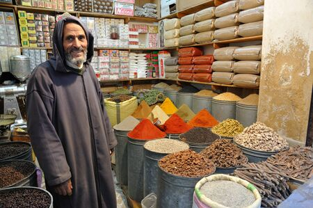 salesperson: Spices seller in the medina of Fes, Morocco. Photo taken at 20th of November 2008 Editorial