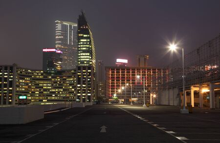 Empty parking lot in the city at night, Hong Kong photo