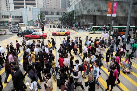 Crowded cross-walk in the city of Hong Kong. Photo taken at 30th of November 2010