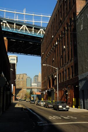 Street in Brooklyn, Manhattan and Brooklyn bridge in the Background. Photo taken at 17th of April 2008
