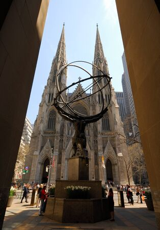 viewed from behind: Saint Patrick Cathedral in New York viewed from behind the statue of Atlas from the Rockefeller Center. Photo taken at 18th of April 2008