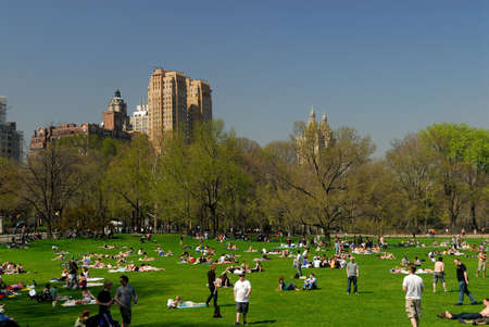 garden city: People relaxing in the Central Park, New York City.  Photo taken at 18th of April 2008 Editorial
