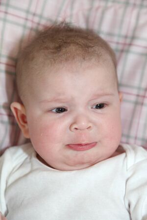 Five month old baby whining photo