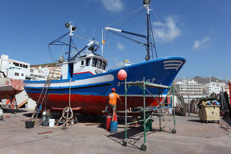 drydock: Fishing boat repair. Los Cristianos, Canary Island Tenerife, Spain. Photo taken at 23rd of February 2011