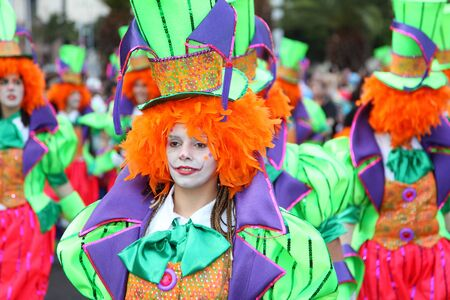 canarias: SANTA CRUZ, TENERIFE, SPAIN - MARCH 8: Santa Cruz de Tenerife Carnival 2011: Woman in a clown costume. Photo taken at 8th of March 2011
