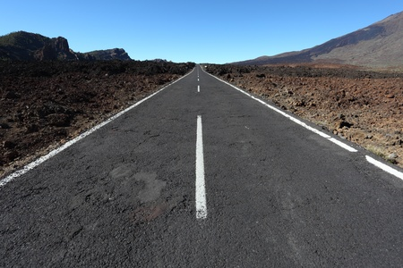 lonesome: Lonesome road through the volcanic landscape of Tenerife, Spain Stock Photo