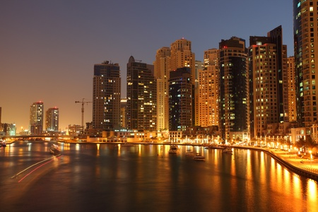 marina: Highrise buildings at Dubai Marina illuminated at night  Stock Photo
