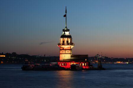 Maiden`s Tower (Kiz Kulesi) illuminated at dusk. Istanbul, Turkey photo