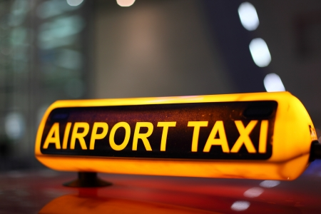 Airport Taxi sign illuminated at night Stock Photo