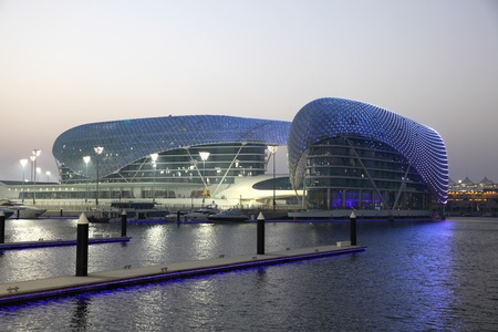Yas Marina Hotel illuminated at night. Abu Dhabi, United Arab Emirates