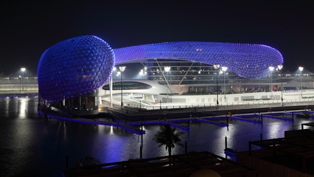 abudhabi: Yas Marina Hotel illuminated at night. Abu Dhabi, United Arab Emirates Editorial