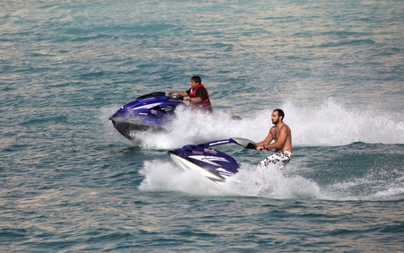 jetski: Young Arab men having fun riding jetski in Dubai, United Arab Emirates. Photo taken at 29th of Mai 2011