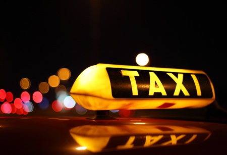 yellow taxi: Taxi sign at night Stock Photo