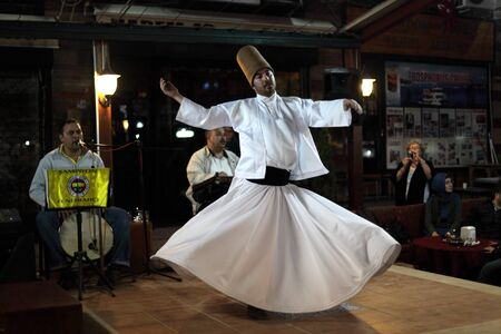 perfomance: Whirling Dervish dancing  in Istanbul, Turkey. Photo taken at 22nd of Mai 2011