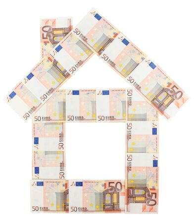 House built of 50 Euro bills over white background photo