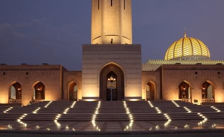 Sultan Qaboos Grand Mosque illuminated at night. Muscat, Oman photo