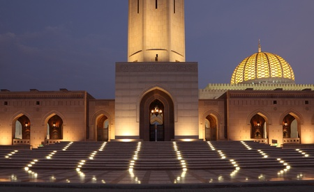 Oman: Sultan Qaboos Grand Mosque illuminated at night. Muscat, Oman Stock Photo