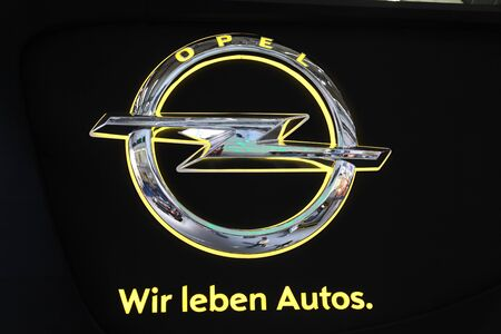 iaa: FRANKFURT - SEPT 24: The Opel Company Logo at the 64th IAA (Internationale Automobil Ausstellung) on September 24, 2011 in Frankfurt, Germany