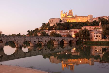 Cathedral and Pont Vieux at night. Beziers, southern France