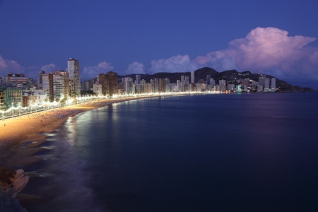 Highrise buildings along the beach of Benidorm at night, Spain photo