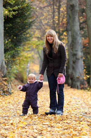 Mother and daughter in an autumnal park photo