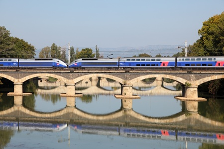 French high speed train TGV crossing the bridge in Beziers, France. Photo taken at 2nd of October 2011