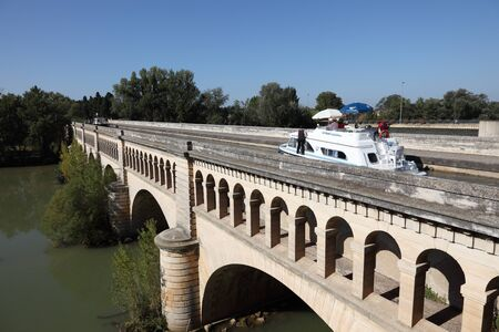 Boat passing Orb Aqueduct of Canal du Midi in Beziers, France. Photo taken at 2nd of October 2011