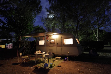European mobile home on a camping site at night. Photo taken at 6th of October 2011 Editorial
