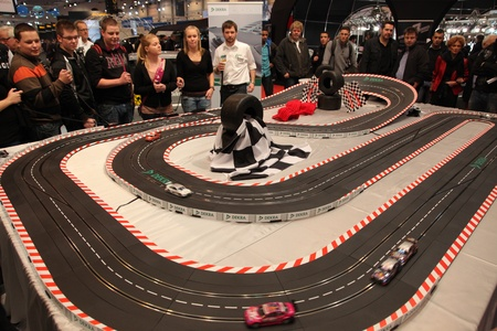 ESSEN - NOV 29: Slot Car Racing Racing Track at the Essen Motor Show in Essen, Germany, on November 29, 2011