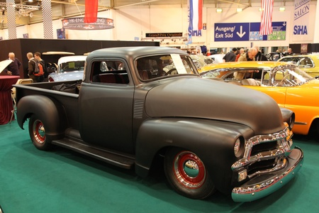 ESSEN - NOV 29: Custom build US Chevy Pickup Truck from the 1950s shown at the Essen Motor Show in Essen, Germany, on November 29, 2011 Stock Photo - 11347993