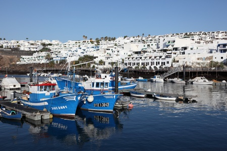 carmen: Fishing boats in Puerto del Carmen, Lanzarote Spain. Photo taken at 16th December 2011