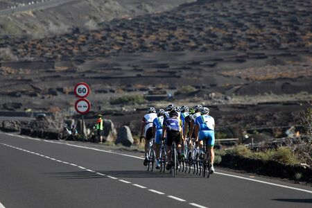 Cyclists on the road in Lanzarote, Canary Islands Spain. Photo taken at 16th December 2011