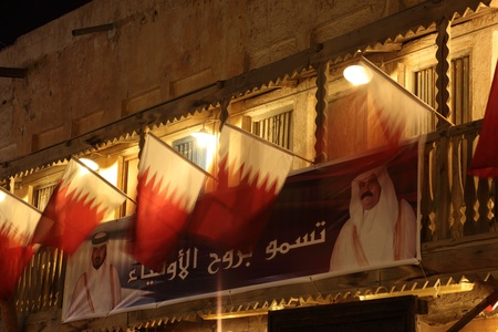suq: Qatari flags and portrait of the Emir of Qatar in Souq Waqif, Doha. Photo taken at 6th of January 2012