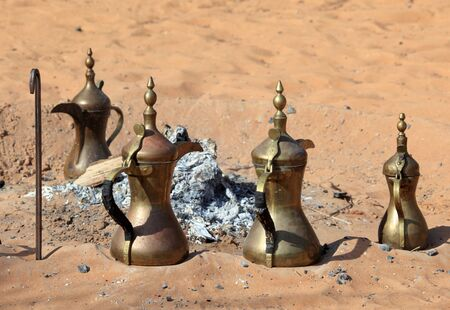 arabic coffee: Traditional Arabic coffee pots at fireplace in the desert